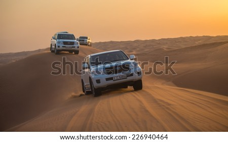 DUBAI - OCTOBER 21: Driving on jeeps on the desert, traditional entertainment for tourists on October 21, 2014 in Dubai