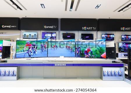 DUBAI - OCTOBER 15, 2014: gadgets and electronics devices shop in the Dubai Mall. The Dubai Mall located in Dubai, it is part of the 20-billion-dollar Downtown Dubai complex - stock photo