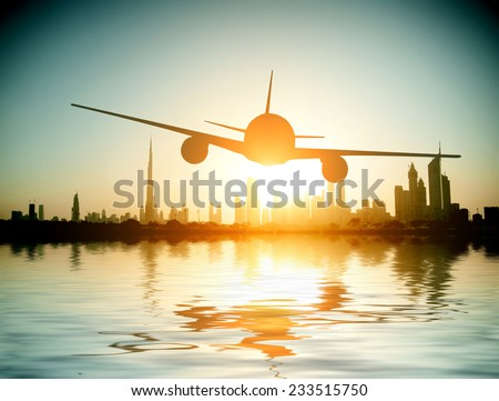 Dubai. plane flies on the background of a beautiful beach and sea.  United Arab Emirates. - stock photo