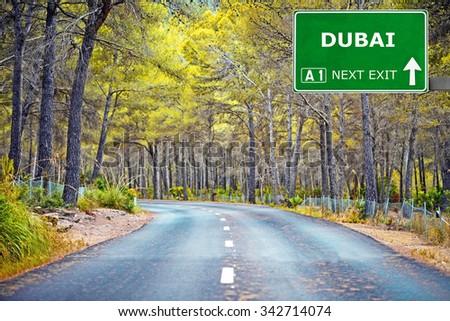 DUBAI road sign against clear blue sky - stock photo