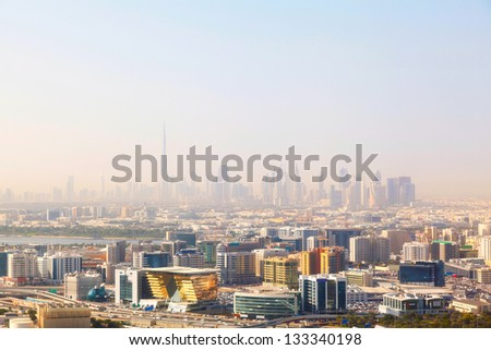 Dubai's skyscrapers and top view on a sunny day - stock photo