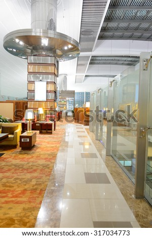 DUBAI - SEPTEMBER 08, 2015: Emirates business class lounge interior. Emirates is the largest airline in the Middle East. It is an airline based in Dubai, United Arab Emirates.