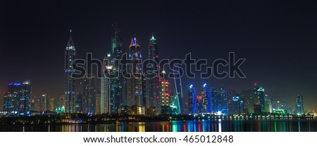 Dubai sity skyline at night and skyscrapers view.
