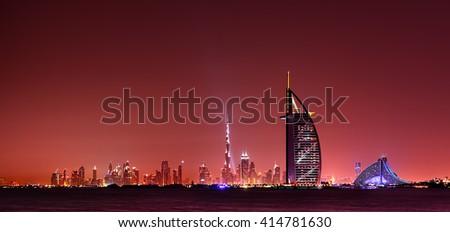 Dubai skyline reflection at amazing night, Dubai, United Arab Emirates - stock photo