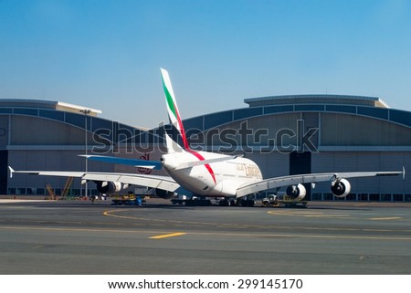 DUBAI, UAE - APR 7:  Planes at Dubai Airport on Apr 7, 2014 in Dubai, UAE. Dubai International Airport is the largest airport in United Arab Emirates