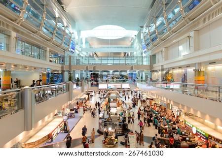 DUBAI, UAE - APRIL 18, 2014: airport interior. Dubai International Airport is an international airport serving Dubai. It is a major airline hub in the Middle East, and is the main airport of Dubai. - stock photo