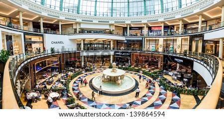 DUBAI, UAE - APRIL 29: Diners at Mall of the Emirates on April 29, 2013 in Dubai. Mall of the Emirates is a shopping mall in the Al Barsha district of Dubai. - stock photo