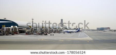 DUBAI, UAE - APRIL 23: Dubai Airport on April 23, 2013 in Dubai, UAE. Emirates handles major part of passenger traffic and aircraft movements at the airport. - stock photo