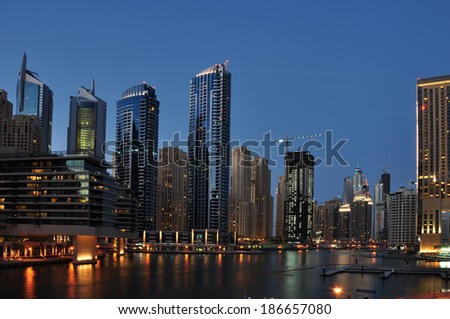 DUBAI, UAE - April 3: Dubai Marina at Dusk Dubai, UAE. In the city of artificial channel length of 3 kilometers along the Persian Gulf.Shot taken on April 3rd, 2013.