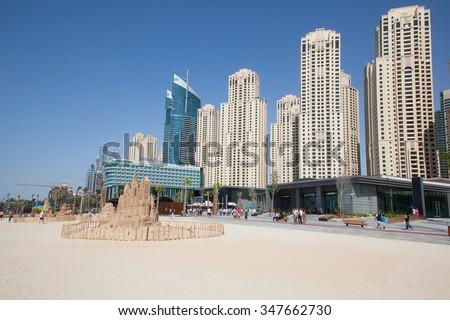 DUBAI, UAE - APRIL 27: Dubai Marina beach on April 27, 2014 in Dubai, United Arab Emirates. Dubai is biggest city of UAE and one of the most popular touristic destination of the Middle East - stock photo