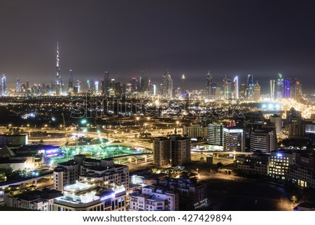 DUBAI, UAE - APRIL 8, 2016: Dubai skyline, dominated by the world's tallest building, the Burj Khalifa, at night. The city has registered a spectacular growth over the last two decades.
