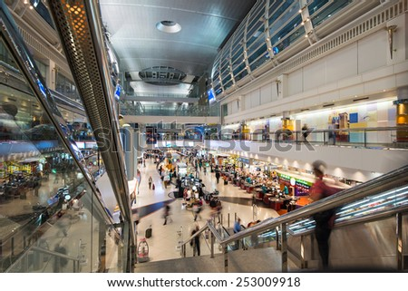 DUBAI, UAE - APRIL 1, 2014: Duty free area inside airport. Dubai International Airport is an international airport serving Dubai. It is a major airline hub in the Middle East. - stock photo