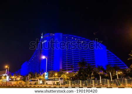 DUBAI, UAE - APRIL 20: Jumeirah Beach Hotel on April 20, 2014 in Dubai, UAE. Well-known for its wave-shaped silhouette, remains one of the best recognizable landmarks of Dubai, UAE