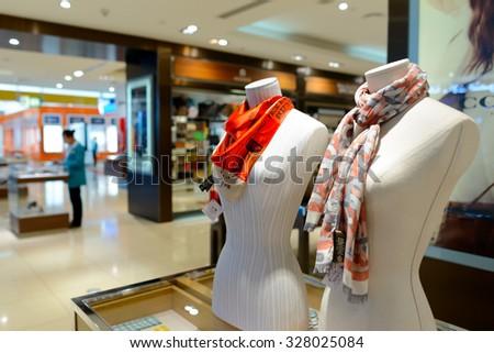 DUBAI, UAE - APRIL 18, 2014: mannequins in the store in Dubai Airport. Dubai International Airport is the primary airport serving Dubai. - stock photo