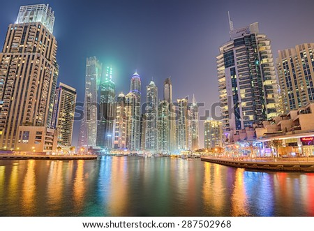 DUBAI, UAE - APRIL 29, 2015 : Modern buildings in Dubai Marina district at night. Hdr processed. - stock photo