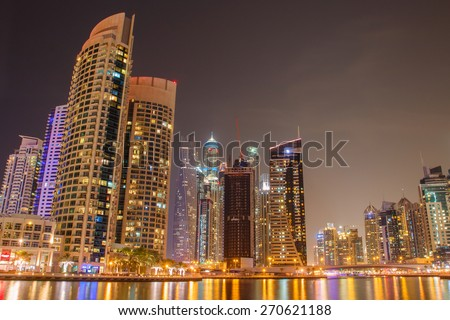 DUBAI, UAE - APRIL 1: Modern buildings in Dubai Marina, Dubai, UAE. Part of city with artificial channel length of 3 kilometers along the Persian Gulf, taken on 1 April, 2015.