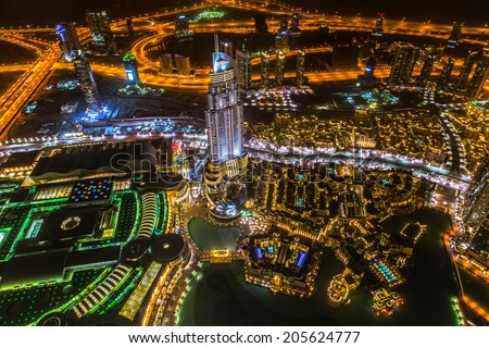 DUBAI, UAE -1 APRIL 2014: Panorama of city centre in Dubai at night, UAE. View from the 124 floor of Burj Khalifa - the tallest skyscraper in the world at 829.8m.