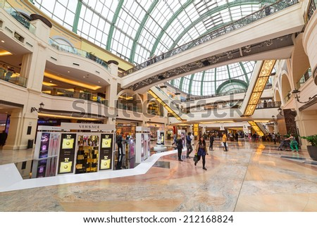 DUBAI, UAE - 3 APRIL 2014: People walking in Mall of the Emirates in Dubai, UAE. Mall of the Emirates is multi-level shopping centre with over 700 stores and Ski Dubai - first indoor ski resort. - stock photo