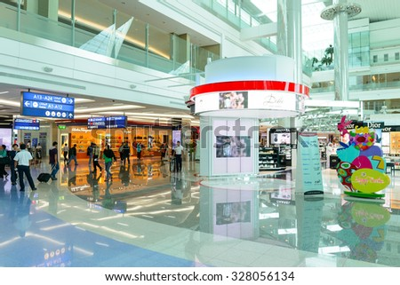 DUBAI, UAE - APRIL 18, 2014: the interior of Concourse A. The concourse includes one 4 star hotel and one 5 star hotel, first and business class lounges, and duty-free areas - stock photo