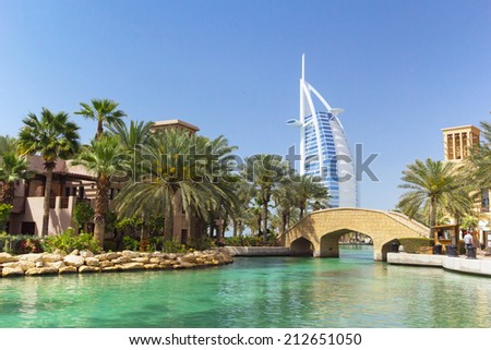 DUBAI, UAE - 1 APRIL 2014: View for Burj Al Arab hotel from the Madinat Jumeirah in Dubai, UAE. Burj Al Arab with 321 meters high is the most luxurious 7 star hotel and a symbol of modern Dubai. - stock photo