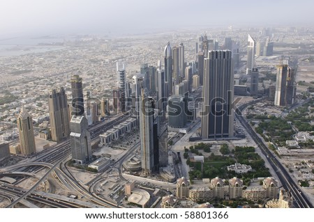 DUBAI, UAE - AUGUST 03: View of the Sheikh Zayed Road from the 124th floor of the Burj Khalifa on Aug 3rd 2010. The observation deck has reopened after closure for maintenance earlier in the year. - stock photo