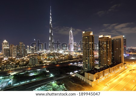 DUBAI, UAE - DEC 28: Burj Khalifa and Dubai Downtown at dusk. December 28, 2013 in Dubai, United Arab Emirates