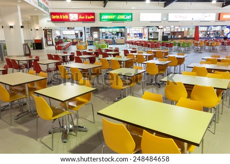 DUBAI, UAE - DEC 13: Food Court at the Dubai Outlet Mall. The shopping mall is part of Dubai Outlet City in Dubai. December 13, 2014 in Dubai, UAE - stock photo