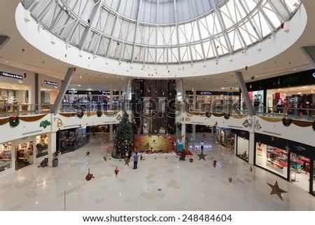 DUBAI, UAE - DEC 13: Interior of Dubai Outlet Mall.  The shopping mall is part of Dubai Outlet City in Dubai. December 13, 2014 in Dubai, UAE - stock photo