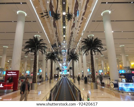 DUBAI, UAE - DEC 19: The newer Terminal 3 (Emirates) at Dubai International Airport, one of the busiest airports, on December 17, 2011. It  is the single largest building in the world by floor space. - stock photo