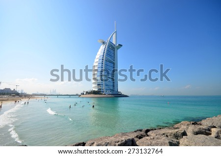 DUBAI, UAE - DECEMBER 26, 2014: Burj Al Arab in Dubai, as seen on December 26, 2014. It is a 7-star hotel built on an artificial island and is the fourth tallest hotel in the world. - stock photo