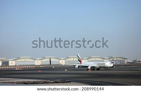 DUBAI, UAE - DECEMBER 09: Emirates Airbus A340 at Dubai Airport on December 09, 2012 in Dubai, UAE. Emirates handles major part of passenger traffic and aircraft movements at the airport. - stock photo