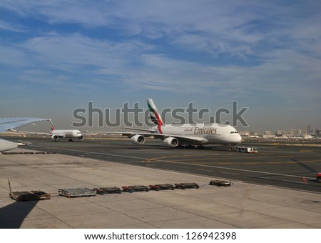 DUBAI, UAE - DECEMBER 26: Emirates Airbus A380 take off at Dubai Airport on December 26, 2012 in Dubai, UAE. Emirates was first customer to place order for the a380. - stock photo