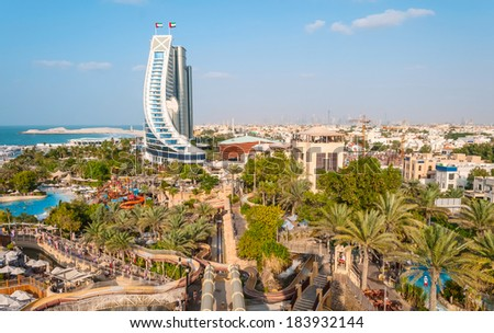 DUBAI, UAE - DECEMBER 10, 2013: Jumeirah Beach Hotel, preceded by beachfront. Well-known for its wave-shaped silhouette, remains one of the best recognizable landmarks of Dubai, UAE - stock photo