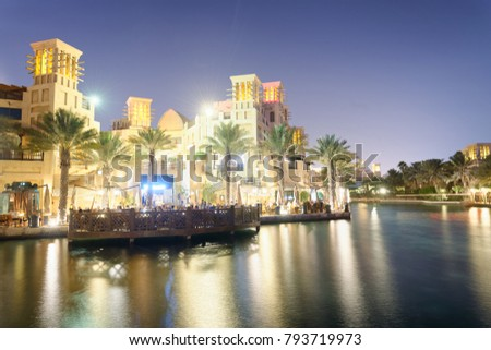 DUBAI, UAE - DECEMBER 9, 2016: Night view of Madinat Jumeirah buildings reflections. The city attracts 30 million tourists annually.