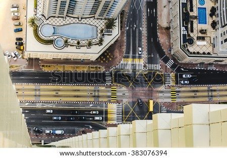 DUBAI, UAE - DECEMBER 09, 2015: Rooftop view of a road intersection in Dubai Marina with hotels and traffic