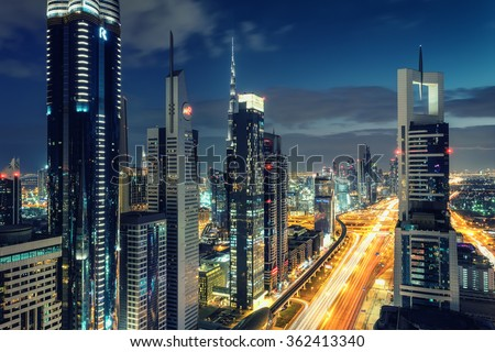DUBAI, UAE - DECEMBER 16, 2015: Scenic Dubai downtown architecture at night. Aerial view of the Sheikh Zayed road with numerous skyscrapers. - stock photo
