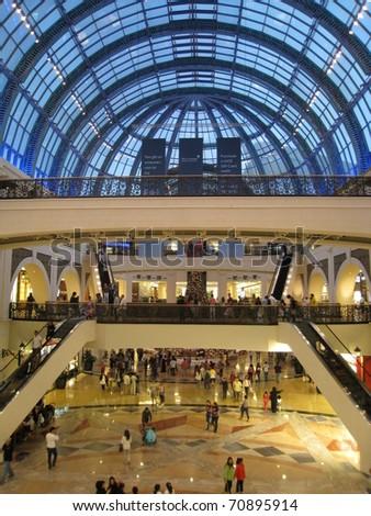 DUBAI, UAE - DECEMBER 28: Shoppers at Dubai Mall December 28, 2010 in Dubai, United Arab Emirates. Dubai Mall is one of the largest mall in the world. - stock photo