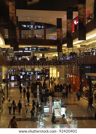 DUBAI, UAE - DECEMBER 25: Shoppers at Dubai Mall on Dec 25, 2011 in Dubai. At over 12 million sq ft, it is the world's largest shopping mall based on total area and 6th largest by gross leasable area. - stock photo