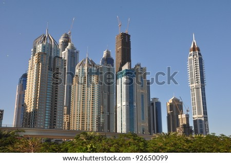 DUBAI, UAE - DECEMBER 26: View of Sheikh Zayed Road skyscrapers in Dubai, UAE on December 26, 2011. More than 25 skyscrapers taller than 100 meters can be found here. - stock photo