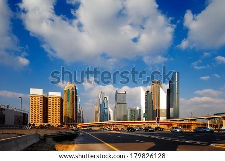 DUBAI, UAE - FEB 19: A view of DIFC at Interchange One from Sheikh Zayed Road on Feb 19, 2014 in Dubai, UAE. DIFC is the financial hub of Dubai. - stock photo