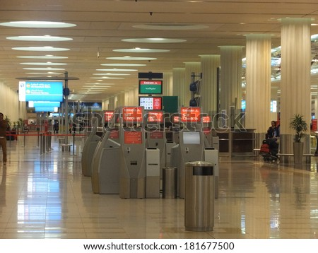 DUBAI, UAE - FEB 1: Departure check-in at newer Terminal 3 (Emirates) at Dubai International Airport, on Feb 22, 2014. It is the single largest building in the world by floor space. - stock photo