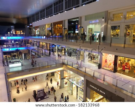 DUBAI, UAE - FEB 16: Dubai Mall in Dubai, UAE, as seen on Feb 16, 2014,. At over 12 million sq ft, it is the world's largest shopping mall based on total area and 6th largest by gross leasable area. - stock photo