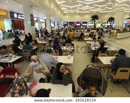 DUBAI, UAE - FEB 9: Food Court at Deira City Centre in Dubai, UAE, as seen on Feb 9th, 2014. The mall opened in 1995 and is the original flagship mall in the Majid Al Futtaim Properties portfolio. - stock photo