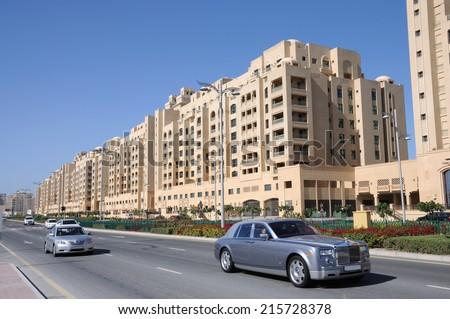 DUBAI, UAE - FEB 12: Luxury cars on the road in Palm Jumeirah. February 12, 2010 in Dubai, United Arab Emirates - stock photo