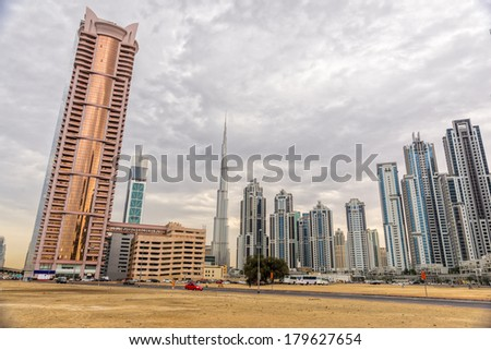 DUBAI, UAE - FEB 08: Skyline view of Dubai showing the Burj Khalifa and skyscrapers of Sheikh Zayed Road  on Feb 08, 2014 in Dubai, UAE. The Burj Khalifa, the tallest skyscraper in the world at 829.8m