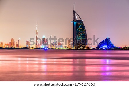 DUBAI, UAE - FEB 08: Skyline view of Dubai showing the iconics Burj al Arab and Burj Khalifa on Feb 08, 2014 in Dubai, UAE. The Burj al Arab is the first seven star hotel in the world. - stock photo