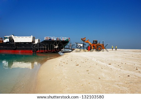 DUBAI, UAE - FEB 20: The heavy plant has arrived in the desert to commence the construction work on Feb 20, 2010 in Dubai, UAE. The World Islands in Dubai is synonymous with the economic crash of 2009 - stock photo