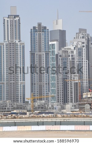 DUBAI, UAE - FEB 3: View of Sheikh Zayed Road skyscrapers in Dubai, UAE on Feb 3, 2014. The Sheikh Zayed Road (E11 highway) is home to most of Dubai's skyscrapers, including the Emirates Towers. - stock photo
