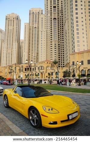 DUBAI, UAE - FEB 19: Yellow sportscar in Dubai downtown. February 19, 2009 in Dubai, United Arab Emirates - stock photo