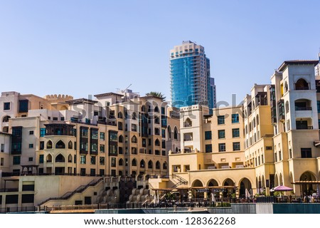 DUBAI, UAE - FEBRUARY 3:  Area of Souk al Bahar hotel and shopping mall in Dubai, UAE, on February 3, 2013. Complex located on The Old Town Island, built in traditional Arabic architectural style. - stock photo